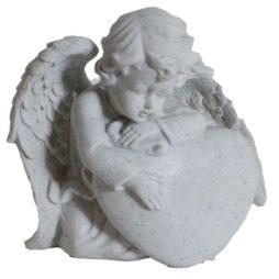 Gravsmyckning ängel vid sten